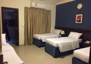 Al-Barakah Hotel bedrooms with air conditioning
